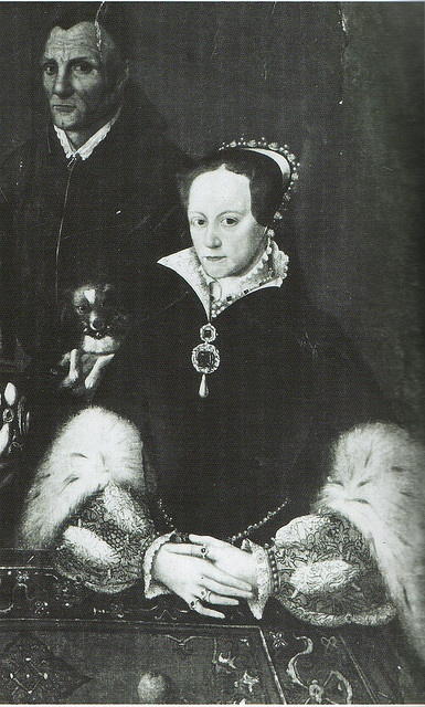 Mary Tudor and her court jester, Will Sommers.  He was the official jester for the Tudor family for many years.