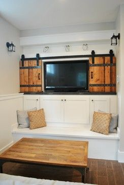 Cute idea to hide the tv. A little too rustic for my taste, though.