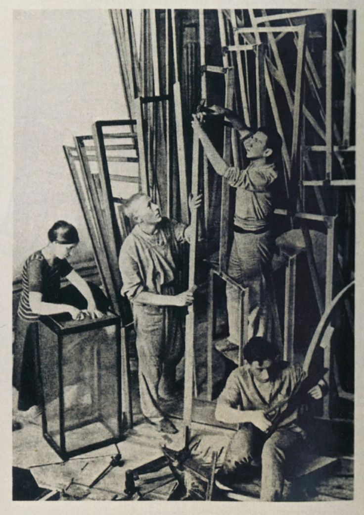 Vladimir Tatlin and assistants constructing his Monument to the Third International (1919).