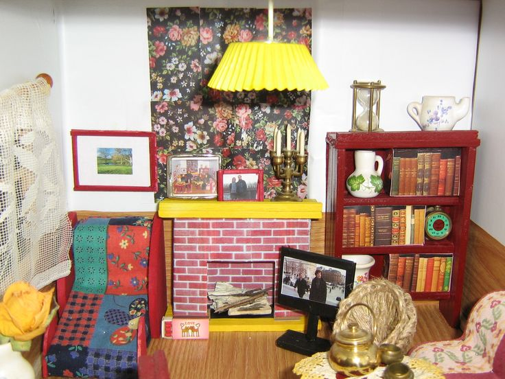 and look at photoframe on fireplace shelf