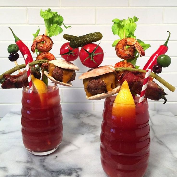 Game day drinks and snacks... Spicy Caesars (a Canadian classic) topped with seared shrimp, jalapenos wrapped in prosciutto and stuffed with cream cheese, mini cheese burgers and an assortment of pickled treats. #Superbowl #snacks #gameday #superbowlfood #tailgate #bloodymary @zimmysnook