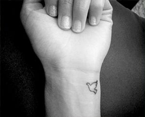 dove wrist tattoo sister tattoo idea?