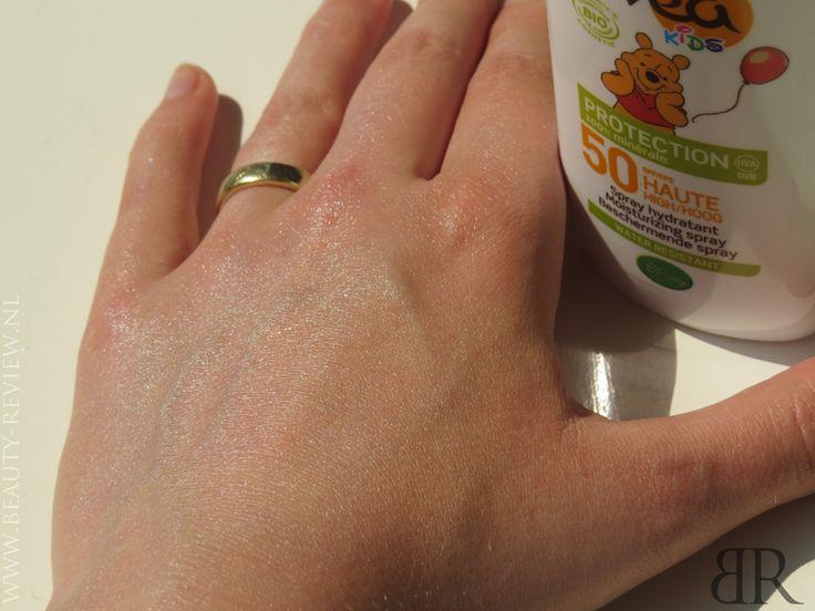 Lovea Bio Spray Kids SPF 50 uitgesmeerd op hand