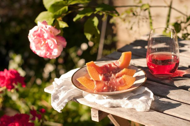 While studying art in college for a year in Italy, I discovered the classic Italian antipasto, Prosciutto e Melone (prosciutto and melon). It couldn't be simpler or tastier on a warm summer evening before dinner! I suggest enjoying it with a Campari aperitif (like Campari and soda) or a glass of chilled Rosé wine. In Italy, the melon slices are cut large, as above, but for parties I like to prepare bite sized cubes of melon wrapped in prosciutto (and a little toothpick to hold each together.