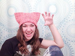 A wonderful movement has been gaining traction on social media in support of the Women's March on Washington, which is now two weeks away. Floods of bright pink hats with pointed corners emulating cat ears are filling up fiber artists' feeds thanks to the Pussy Hat Project.