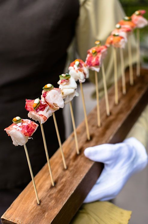 The hottest (and most adorable) trend in wedding food is the passed appetizer. From bite-sized toast to stunning spring rolls served in cucumbers, these indulgences are easy to handle and simple to snack on!