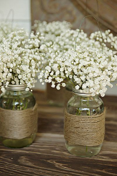 Instead of bouquets, give each bridesmaid a minivase of baby's breath in a twine-wrapped mason jar to carry...