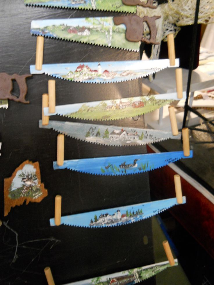Amazing paintings on two handed hand saw blades.