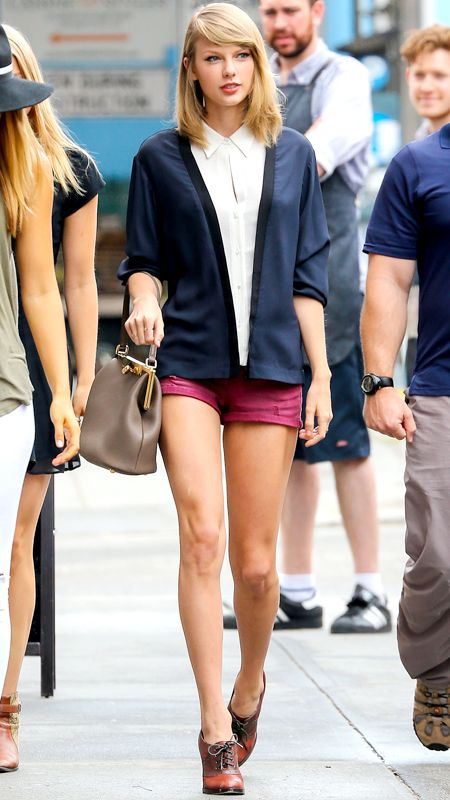 24 Reasons Why Taylor Swift Is a Street Style Pro - JUNE 19, 2014 Swift made a case for preppy summer attire in an A.L.C. blouse, bright short shorts, Oxford heels, and her trusty Dolce & Gabbana handbag.