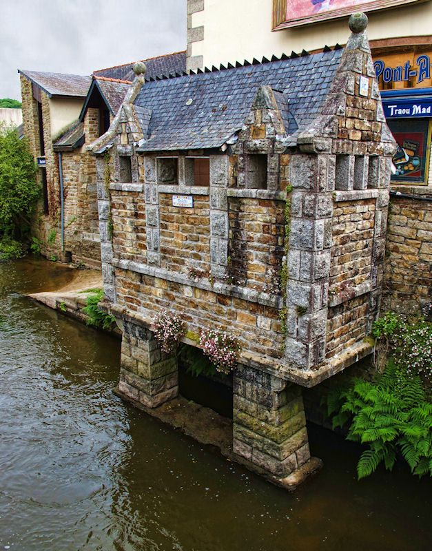 Pont Aven, Brittany, France. I think this little building has quite an un-expected use.