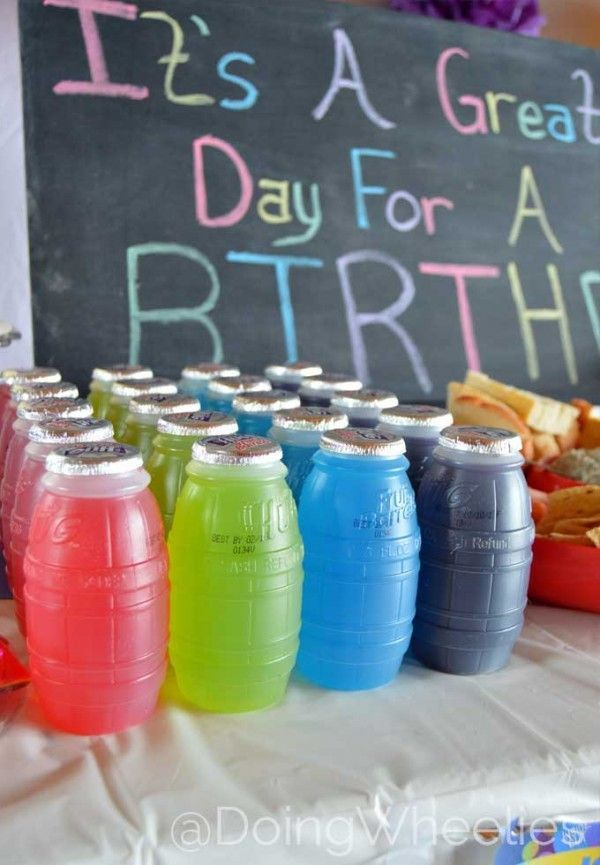 Adorable chalkboard display and rainbow drinks for a colorful girl's birthday party.