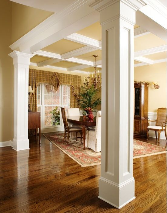 I adore the columns and moulding and ceiling trim, it ads depth to teh room. I would do a darker wood on the floors.