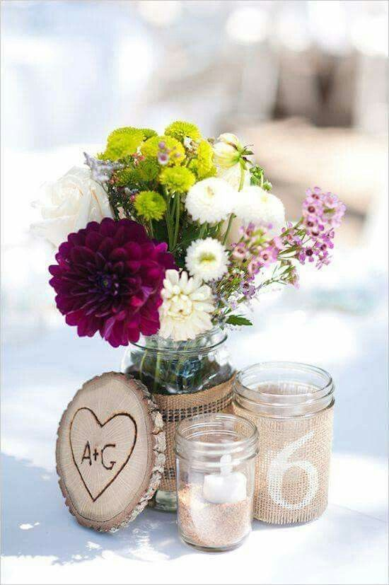 This is like the look i want for our party and i love the idea of incorporating sand from our beach wedding into the centerpiece, love the wood cookie with initials carved into it