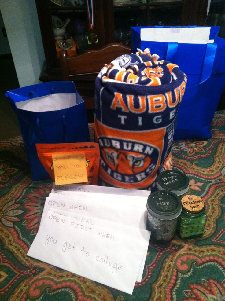 """Going away college care package for boyfriend! Tie blanket sprayed with your perfume, open when... letters, jar of pieces of paper each with X amount of reasons you love him on them, jars with Hershey kisses for """"if he wants a kiss"""",  a bag of Reese's that says """"I love you to pieces"""". Made this for my boyfriend  he LOVED it. He said it was all thoughtful, cute,  going on his desk at school."""