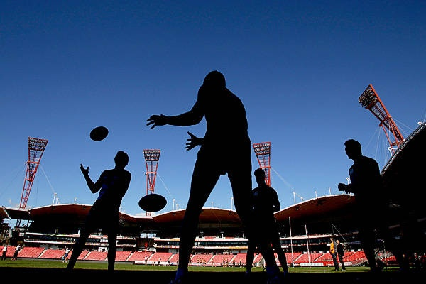 Giants players complete a drill during a GWS Giants AFL training session at Skoda Stadium