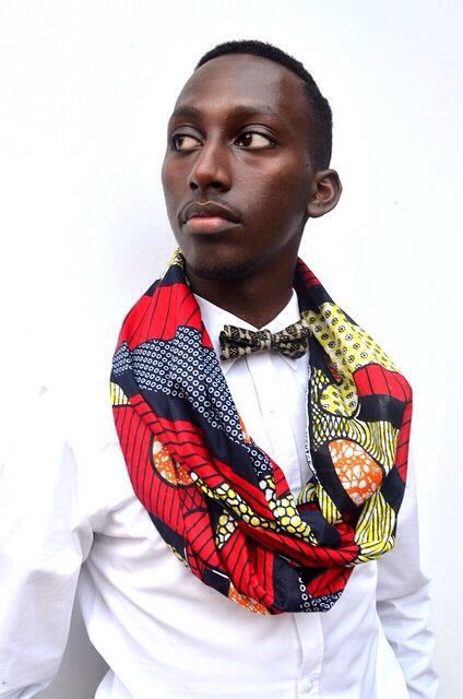 He's a cutie! I love the kente cloth infinity scarf over the crisp white shirt and bowtie.
