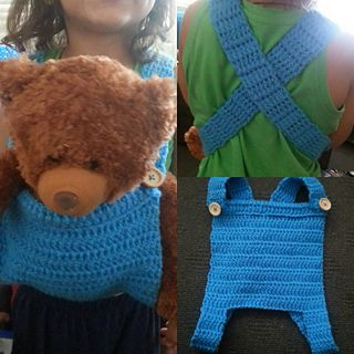 What little girl or boy doesn't want to carry their doll / teddy around?