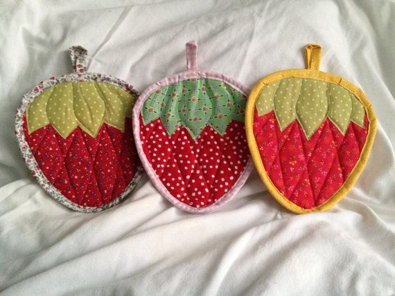 Pick a strawberry to help you in the kitchen! Or pick a couple! These vibrant, decorative pot holders are quilted with two layers of batting,
