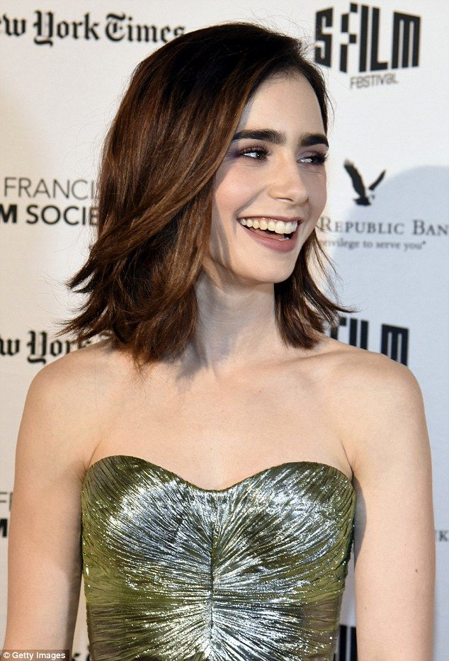 What a beauty: The British/American star's shoulder length brunette tresses framed her imm...