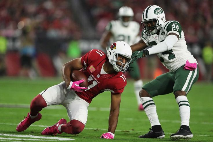 Monday Night Football: Jets vs. Cardinals:     October 17, 2016  -  28-03, Cardinals  -    Wide receiver Larry Fitzgerald of the Arizona Cardinals makes a catch in front of cornerback Darrelle Revis of the New York Jets in the first quarter during the NFL game at the University of Phoenix Stadium on Oct. 17, 2016 in Glendale, Ariz.