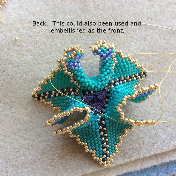 Helpful hints and tips on making the warped beaded triangle. Part of my geometric beadwork journey. How to create a necklace with beaded triangle.