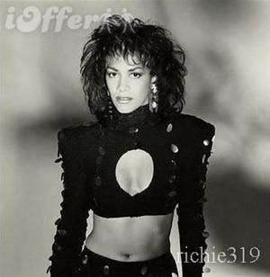 In a cutout top is listed (or ranked) 5 on the list Hot Sheila E. Pics