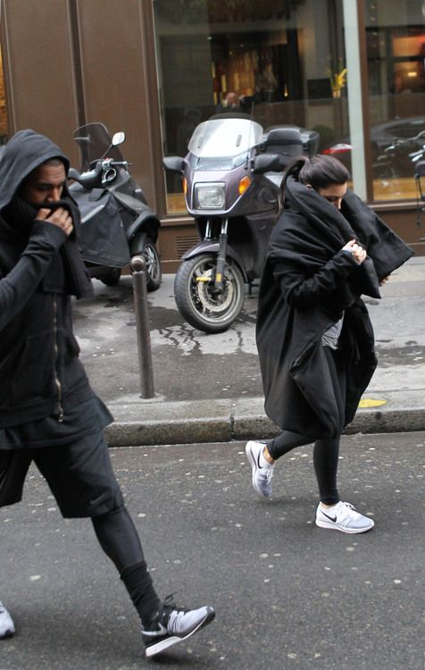 kim and kanye in partner look showing off one of our