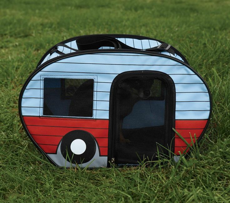 Retro travel trailer-styled carrier is perfect for small pets weighing up to 10 lbs. Made of durable 600D polyester fabric with PVC coating and mesh windows and doors for ample ventilation. Adjustable