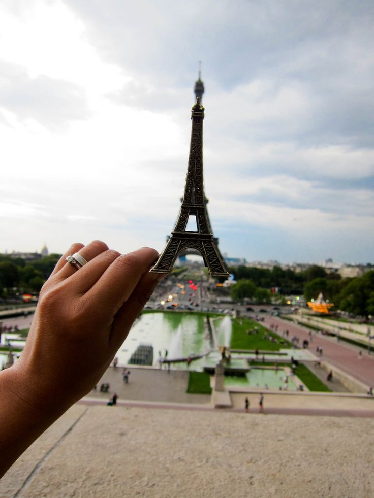 Take a juxtapose photo at the Eiffel Tower #paris #travel