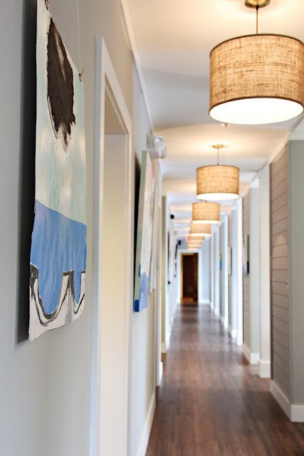 Dental office: hallway.  Love the dark floors, and the light fixtures, gray/blue walls are nice!