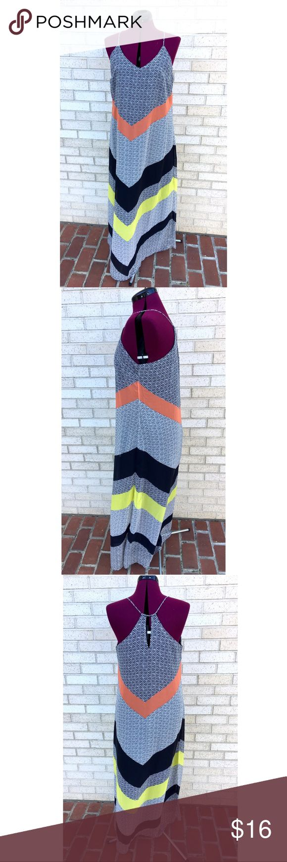 Old Navy Maxi Dress Festival Vacation Chevron Old Navy maxi dress. Great design with a large chevron pattern of orange, black & yellow, mixed with a more intricate black & white pattern! Excellent condition. Spaghetti straps with a flowing feel throughout. Perfect dress for vacation or the summer months ahead! Great for festivals, too! Old Navy Dresses Maxi