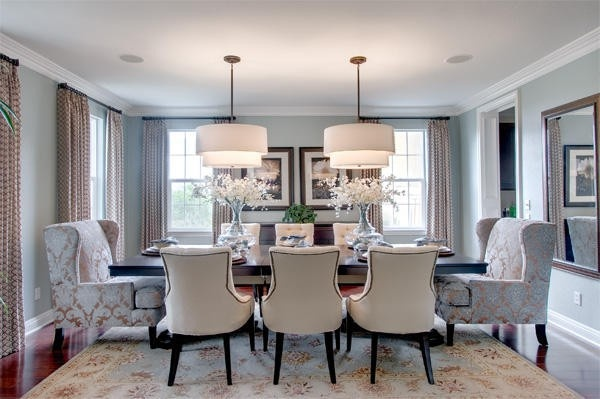 Dining should be about comfort and this room achieves exactly that with big cozy chairs and a large table that seats 8. How will you set up the dining room in your new home?