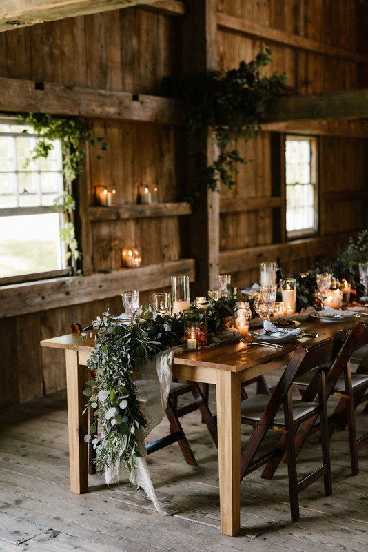 Rustic + modern wedding reception decor - wooden,  farm table with greenery garland centerpiece {Lindsey M. Events}