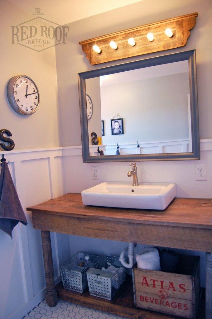 Boys' Farmhouse Bathroom Remodel | Barn wood vanity | grey bathroom | board and batten | re-purposed vanity light | fixer upper farmhouse