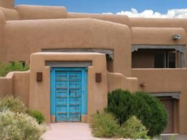 Wow, I love the earthiness of Santa Fe design with the pop of color in the turquoise door. It reminds me of turquoise jewelry.