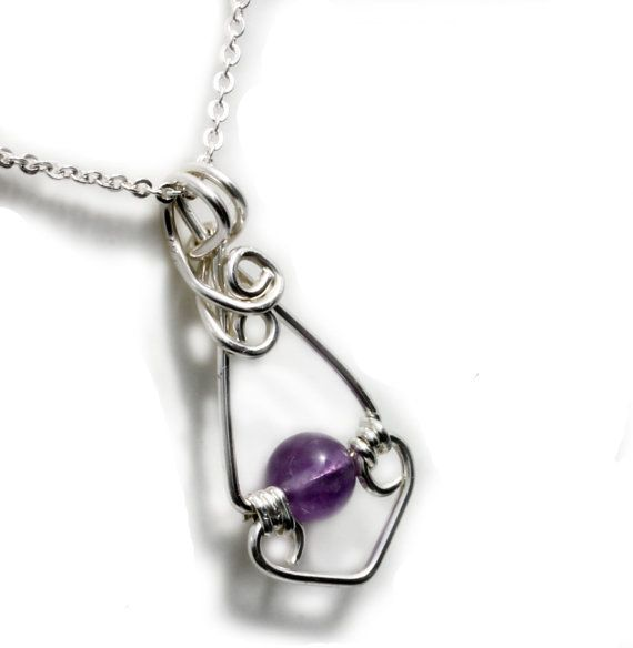 Soothing Amethyst gemstone is handmade with sterling silver wire wrapped creating a gorgeous minimalist pendant that can be worn layered.    The handmade amethyst gemstone pendant is approximately 3.2 cm x 1.5 cm and it comes on a silver plated chain. or with a 50 cm sterling Silver Chain. Please see variations.        AMETHYST GEMSTONES      A stone for Sobriety, Calm, Balance, and Peace.    Promotes Peacefulness, Happiness, and Contentment.    Symbolizes Piety, Humility, Sincerity and…