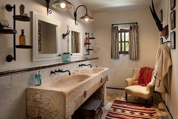 The sink, burlap curtains, upholstered chair, ledge running above sink, rug on floor, and the colors!