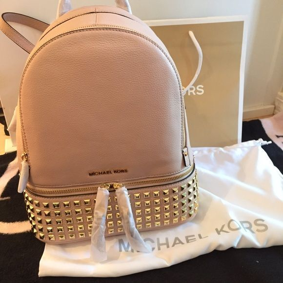 NWT Michael kors rose gold backpack Absolutely love this backpack I just bought it on a whim and decided it's not really my style anymore! A little bit girly but the studs made it edgy, and backpacks are so in right now! Perfect for spring/summer Michael Kors Bags Backpacks