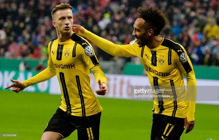 Dortmund's German striker Marco Reus (L) celebrates his goal during the German Cup DFB Pokal semifinal football match between FC Bayern Munich and BVB Borussia Dortmund in Munich, on April 26, 2017.