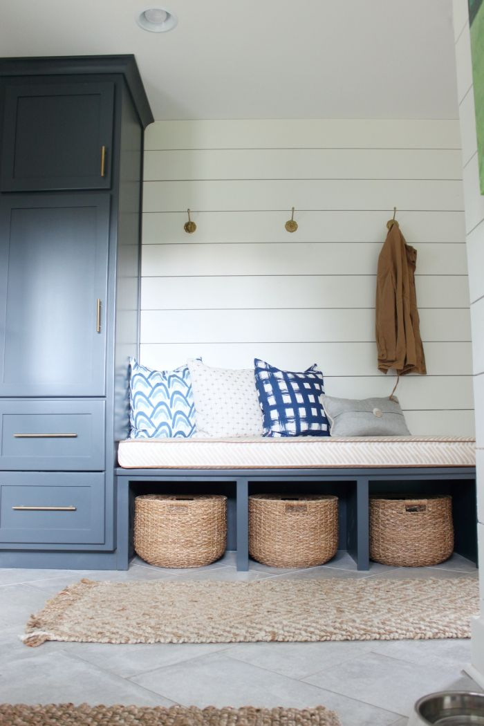 Painted tall cabinets, shiplap with hooks. Baskets under bench to hide items away with easy access.