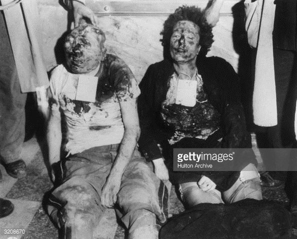 View of the mutilated bodies of Benito Mussolini and his mistress, Clara Petacci, propped up against a marble wall in Milan, Italy, World War II. The couple had tried to escape to Switzerland but...