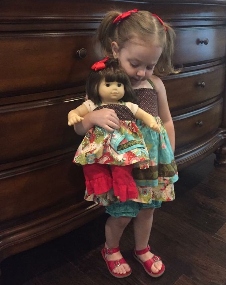 This adorable little girl is wearing her Matilda Jane Sun Porch Ellie, and her doll is wearing the mylittlepoppyseed version of this beautiful dress!