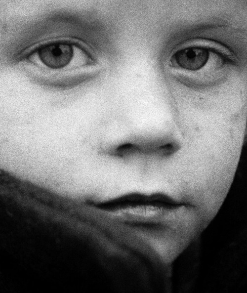 Child at Pamhagen, Nov. 1956 -by Ata Kandó  [from: Hungarian refugees in the border area between Austria and Hungary]