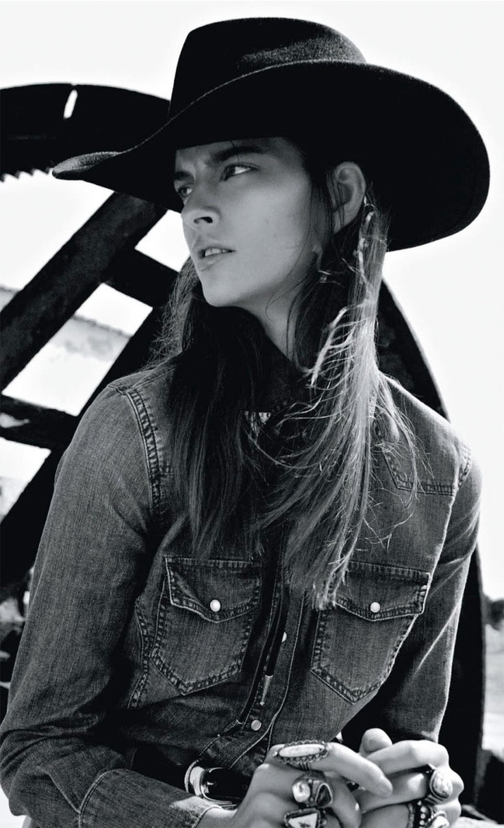 A Cowgirl looking far off in the Would
