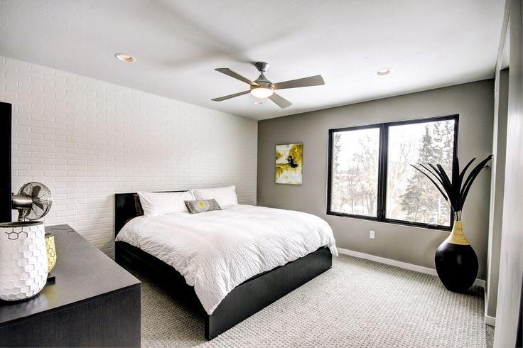 Modern 4 Blade Steel Fan, Contemporary Master Bedroom with flush light, West Elm Hive Vases, Ikea malm bed frame, Carpet, Ceiling fan