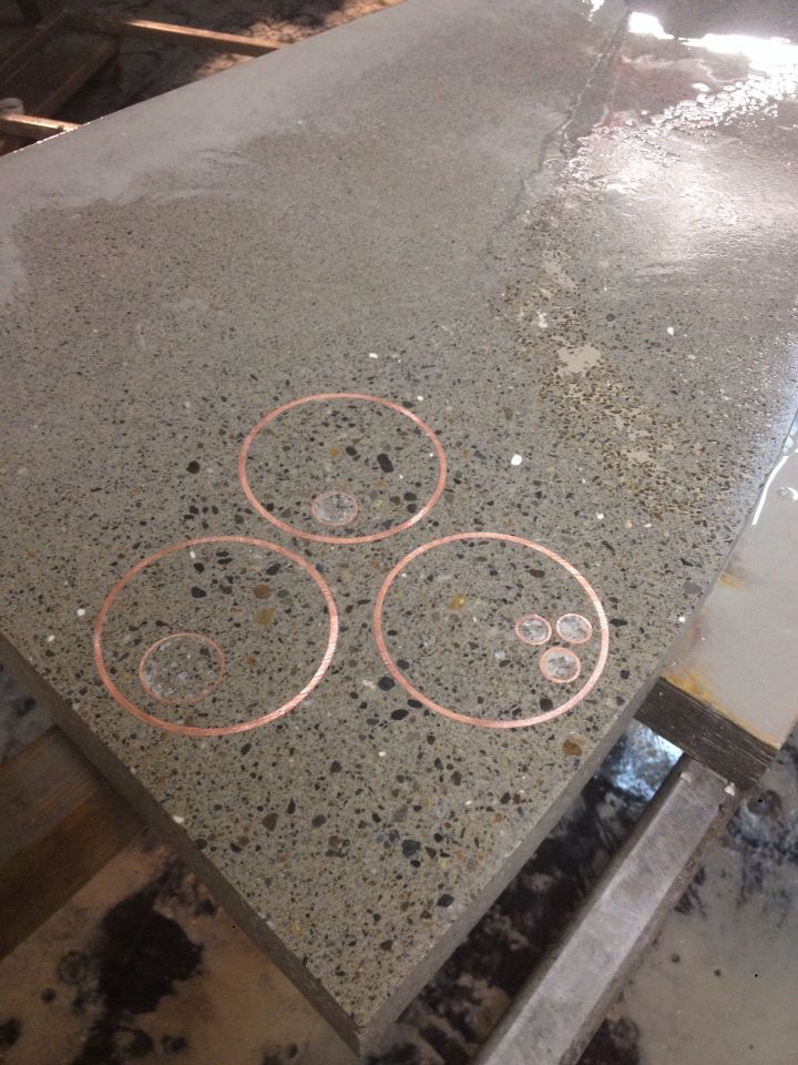 Copper inlay in concrete countertop done by student at www