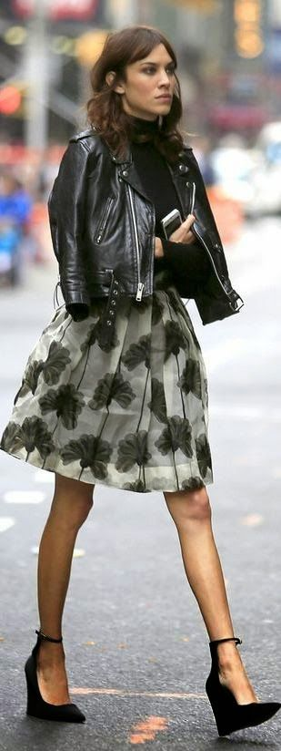 I love this entire outfit! From the skirt with the beautiful funky print and bubble shape to the wedges and Moto jacket, perfect!