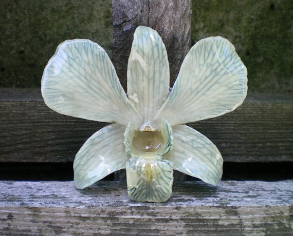 Hair accessories made from REAL flowers preserved in resin. Etsy.