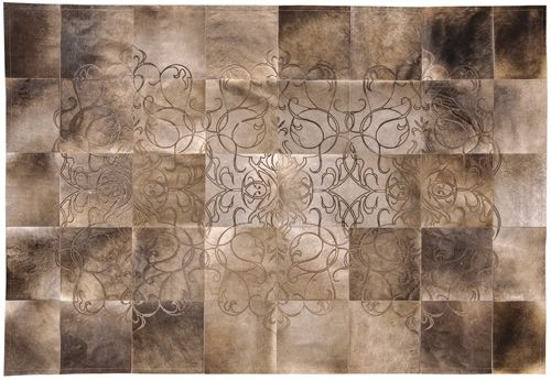 FILIGRANO RUG - Art Hide's out-of-this-world Filigrano design guarantees to make your room something spectacular with its graceful curves and beautiful natural contrasts.  The Luneta is created from premium Argentinian cowhide leather, cut and joined together with commercial grade nylon thread. Tile sizes vary according to size of rug. It has a ribbon edge finish. Art Hide is always sourced as a by-product.