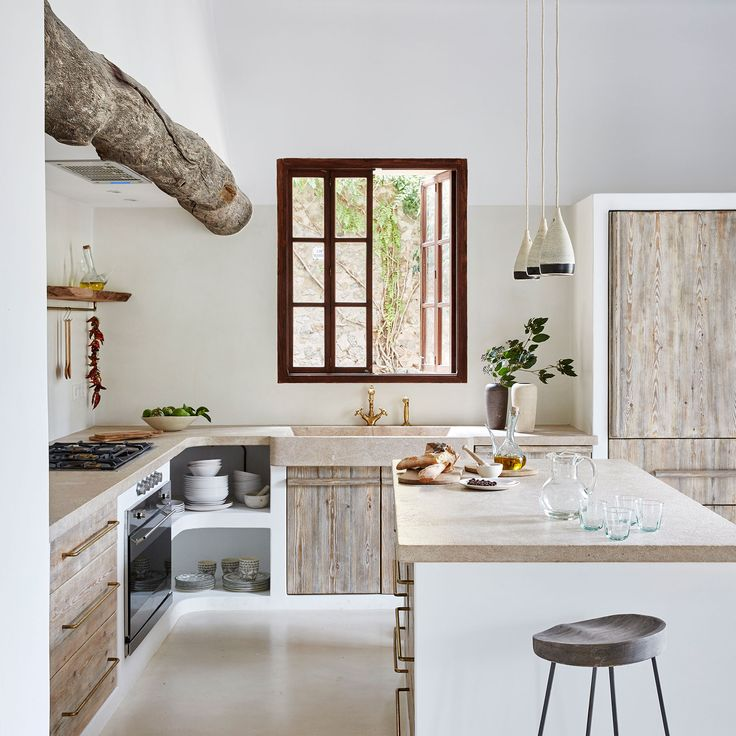 Mallorca Villa, Elle Decor UK, July 2017. Photo: Greg Cox. The kitchen doors are constructed from whitewashed wood. The lights are by Senaia Studio and the stools are from Restoration Hardware.
